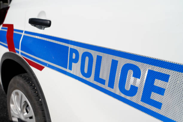 Sign of Municipal French police on white car