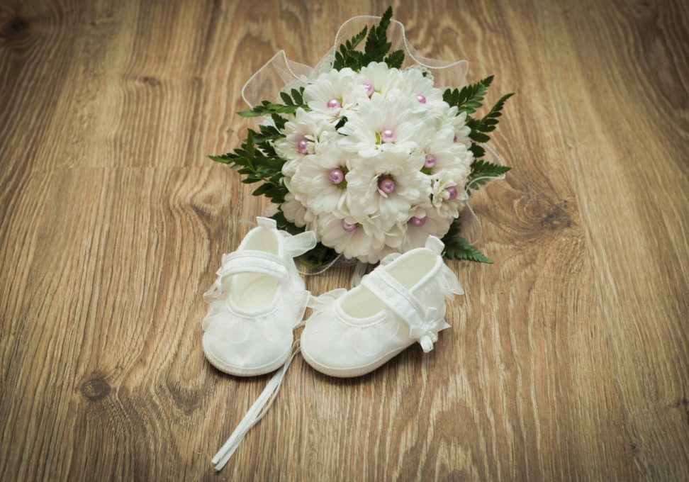 white shoes and white bouquet on a wooden floor